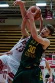 Junior Evan Nichols fights for the rebound against Jeffersonville junior Gerrin Moore. Photo by Robert Wormley.