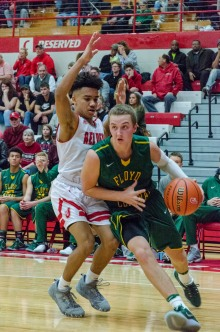 Senior Tyler Kimm drives the ball past a Jeffersonville defender. Photo by Robert Wormley.