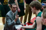 Head coach Todd Sturgeon briefs senior Trevor Apple on the next play during a timeout in the third quarter. The following night the Highlanders defeated North Harrison 57-41. Photo by Robert Wormley.