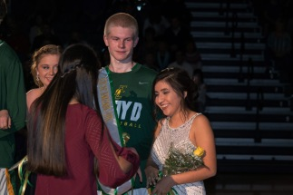 Fall homecoming queen senior Gracie Fitzgerald crowns winter homecoming queen Samanta Garcia.