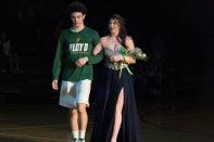 Sophomore Cobie Barnes and Cassie Thomerson walk to center court.