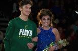 Sophomore Cam Sturgeon escorts senior Tiffany Tolone.