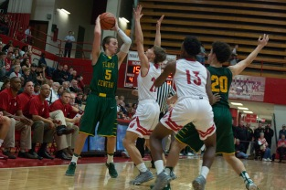 Jeffersonville sophomore Joe LaGrange throws his hands up to block senior Tyler Kim from passing the ball. Photo by Nik Vellinger.
