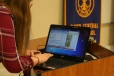 Sophomore Caitlynn Saltzgaber gets Pamela Poe's PowerPoint ready to present to the other members of the Interact Club.