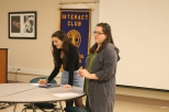 Sophomore Grace Mcbroom and senior Sofia Franco take attendance to make sure members meet the required amount of meetings in order to get recognized at graduation.