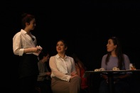 Sophomore Elizabeth Hallal plays the waitress to diners Sieg and Kelly.