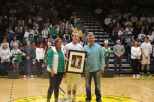 Senior Tyler Kimm stands with parents Mindy and Jay Kimm. Photo by Kaitlyn Erdman.
