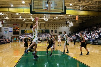 Junior Luke Gohmann jumps up for a shot. Photo by Kaitlyn Erdman.