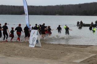 Andrews Hottie's runs into 48 degree water as the police and their dive team watch over to make sure no one gets injured. Photo by Miranda Legg.