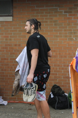 Junior Garrett Moon heads over to the changing area to get out of his soaking wet clothes. Photo by Miranda Legg.