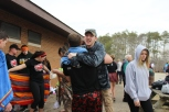 Senior Chas Adams hugs senior Andrew Shaffer. Shaffer smiles with joy after seeing Adams plunge for him. Photo by Miranda Legg.
