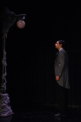 Burger looks on at the lamppost on the side of the stage. This lamppost represents death, and characters move past it when Time comes.
