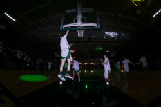Junior Brendon Hobson reaches up to dunk the ball during warm ups. Photo by Nik Vellinger.