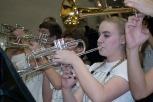 Senior Emily Davis plays the school fight song on her trumpet. Photo by Nik Vellinger.