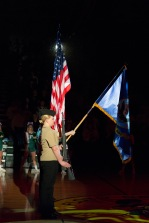 Sophomore Molly Sorrels holds her rifle during the national anthem. Photo by Nik Vellinger.