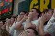 Senior Adam Rutledge chants along with the Kilt Krew. Photo by Nik Vellinger.