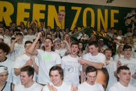 The Kilt Krew dresses up in all white in support of senior night. Photo by Nik Vellinger.