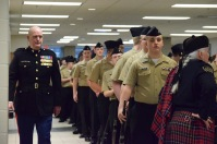 FC Senior Naval Science Instructor (SNSI) Michael Epperson quickly inspects the company before marching into the gym. Photo by Kiley Swain.