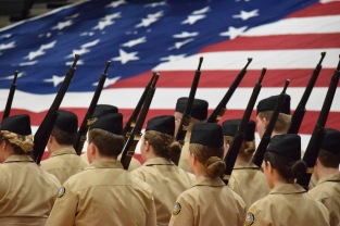 The armed platoon marches to their spot on the gym floor with the rest of the company in tow. Photo by Kiley Swain.