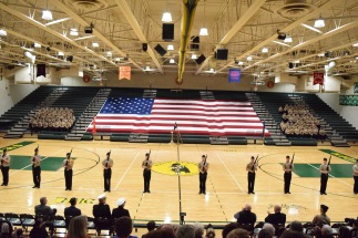 The Armed Exhibition Drill Team lined up across the gym with the rest of the company in the bleachers behind them spectating the performance. Photo by Kiley Swain.