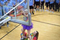 Senior Morale captains Abby Beard and Emma Pappas lift senior Cami Ferguson to dunk a basketball into the hoop during a breakout session. Photo by Kiley Swain.