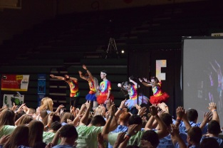 As part of the morale dance, FCDM dancers lift their arms in the air. Photo by Kiley Swain.