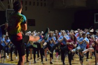 Senior Carson Conley teaches the second part of the morale dance to the participants. Photo by Kiley Swain.