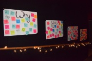 """Students write their reason for dancing at FCDM on the """"Why you dance"""" signs in the inspiration room. Photo by Kiley Swain."""