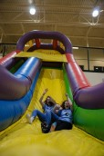 Freshmen Olivia Hartz and Gabby Gobbel race down the slide. Photo by Robert Wormley