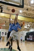 Seniors Lucas Hertle and Jimmy Quenichet battle for a rebound during the preliminary portion of the basketball tournament. Photo by Robert Wormley.