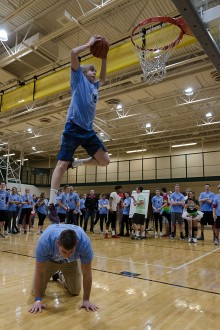 Senior Chandler Stumler jumps off senior Anthony Hodge's back and successfully dunks during the dunk contest. Photo by Robert Wormley.
