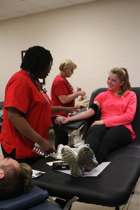 Senior Ashley Grider gives blood during the blood drive. Photo by Rebeca Flores