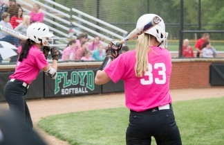 Seniors Taylor Castleberry and Jensen Striegel prepare to bat in the first inning.