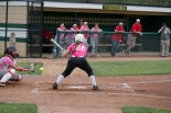 Sophomore Dallas Henderson watches the ball as it flies past her and into the catcher's glove.