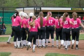 The team huddles together at the end of the end of the second inning.