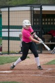 Sophomore Lexie Heeke swings at a strike.