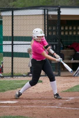 Sophomore Lexie Heeke swings at a strike.