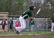 Senior Max Baumann makes contact with the ball and runs to first.