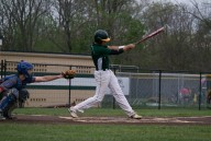 Senior Jon Cato swings at a strike.