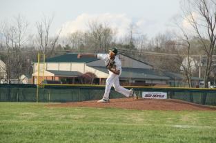 Junior Alex Lozado pitches against Jeffersonville.