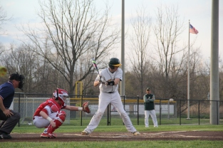 Senior Jon Cato bats at the plate.