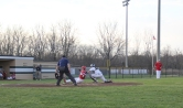 Senior Jon Cato tags out a Jeffersonville player for a big out at home.