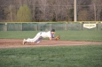 Junior Braxton Cerqueira makes a diving stop at first base.