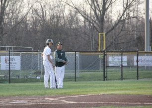 Junior Alex Lozado and head coach Casey LaDuke talk during Lozado's at-bat.