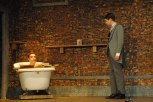 Junior Jordan Burger (Dr. Treeves) talks to sophomore Noah Hankins (John Merrick) as he takes a bath.