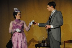 Junior Jordan Burger (Dr. Treeves) hands junior Allie Lincoln (Mrs. Kendal) a glass of wine as they talk about the Elephant Man.
