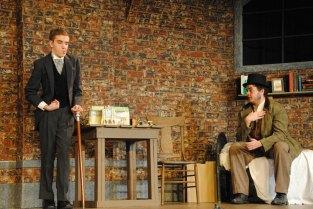 Sophomore Noah Hankins (John Merrick) listens to junior Sam Moore (Ross).