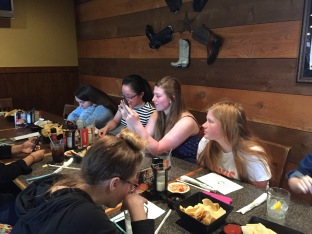 On Tuesday, April 25 juniors Audra McFerran,Tina Liu, sophomores Caitlynn Saltzgaber and Madelyn Lopp wait patiently to place their order.