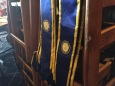 President and vice president Interact Club sashes hang near the meeting.