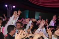Students throw their hands in the air. Photo by Eleni Pappas.
